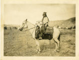 Columbia woman on horseback with papoose